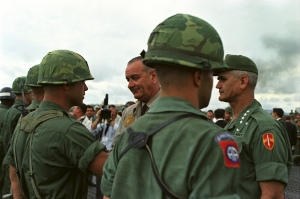 Pres. Johnson visit troops in Vietnam.